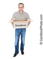 Happy man holding donation box
