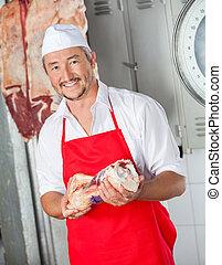 Happy Man Holding Meat In Butchery