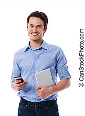 Happy man holding mobile phone and digital tablet