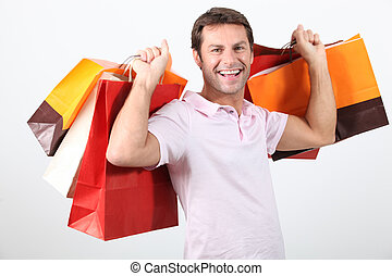 happy man holding shopping bags