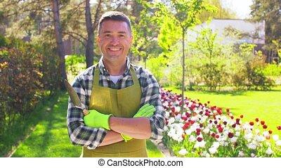 happy man in apron with scoop at summer garden - gardening ...