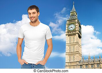 happy man in blank white t-shirt over big ben