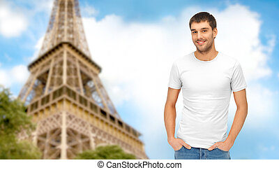 happy man in blank white t-shirt over eiffel tower