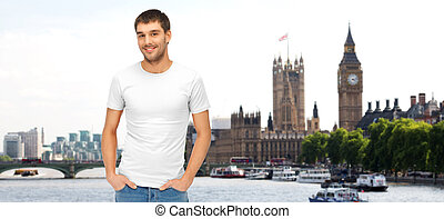 happy man in blank white t-shirt over london city