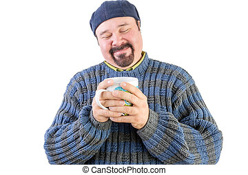 Happy man in blue sweater with hot beverage