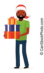 Happy man in christmas hat with a gift for a holiday. African american family