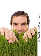 Happy man in green grass - isolated