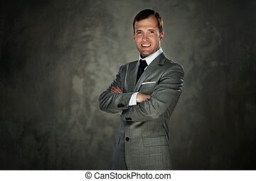 Happy man in grey suit