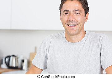 Happy man in kitchen