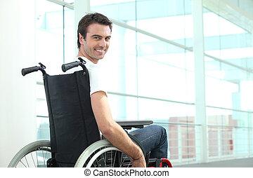 Happy man in wheelchair