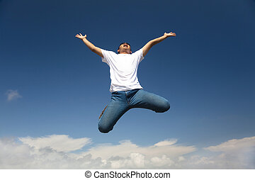 Happy man jumping with  blue sky background