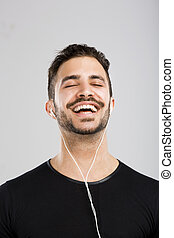 Happy man listen music - Portrait of latin man smiling and ...