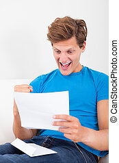 Happy Man Looking At Paper