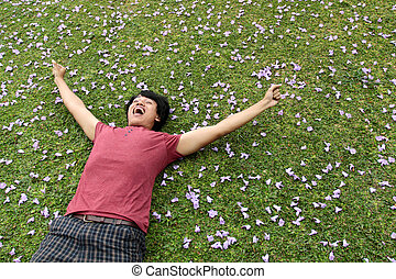 man lying on the grass