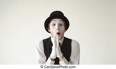 happy man mime with positive emotions on a white background