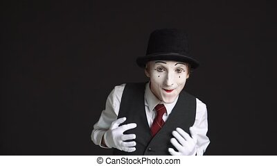 happy man mime with positive emotions on a black background