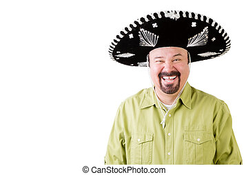 Happy man on holiday wearing a sombrero