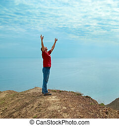 Happy man on the cliff