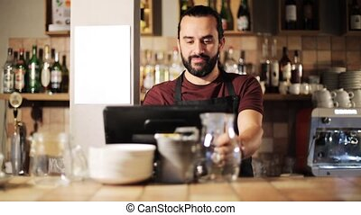 happy man or waiter at cashbox in coffee shop - small...