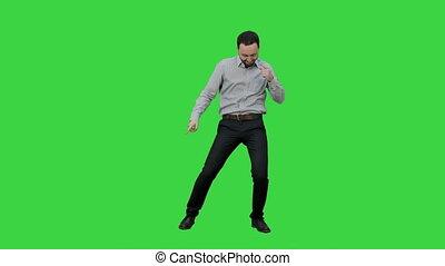 Happy man performing dance on a Green Screen, Chroma Key.