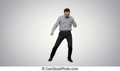 Happy man performing dance on white background.