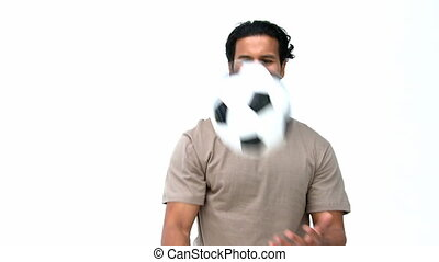 Happy man playing with a soccer ball