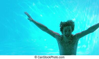 Happy man posing underwater