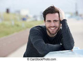 Happy man posing with hand in hair