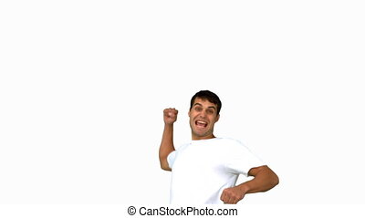 Happy man raising arms on white scr
