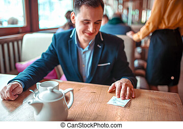 Happy man read love note with a phone number