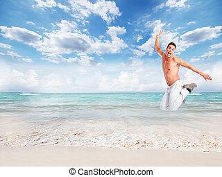 Man running on the beach.