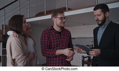 Happy man shaking hands to realtor agent after sign contract on