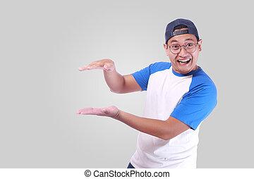 Happy Man Showing something Between Hands, Empty Copy Space Concept