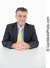 Happy man sitting at his desk