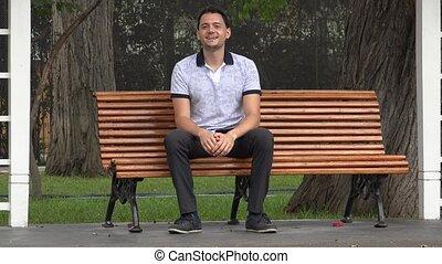 Happy Man Sitting On Bench