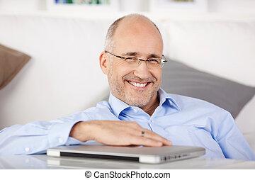 Happy man sitting on the floor