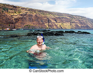 Happy man snorkeling