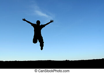 Happy man - A happy man jumping in the air, in silhouette