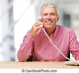 Happy Man Talking On Telephone