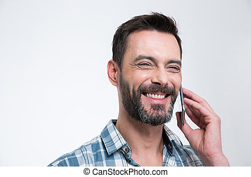 Happy man talking on the phone