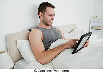 Happy man using a tablet computer