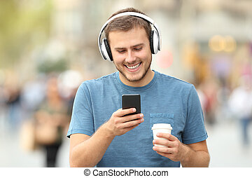 Happy man walking listening to music
