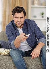 happy man watching tv at home