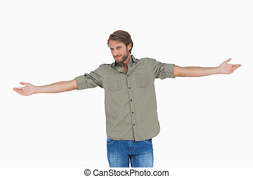 Happy man with arms outstretched