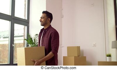 happy man with box moving to new home and dancing - moving,...