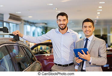 happy man with car dealer in auto show or salon - auto...
