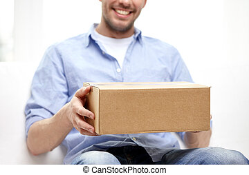 happy man with cardboard box or parcels at home - delivery,...
