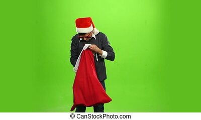 Happy man with christmas present, green screen