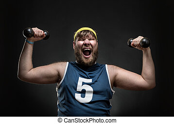 Happy man with dumbbells