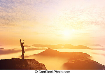 Happy man with hands up on the top of the world above clouds. Bright future